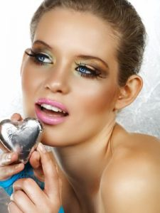 Blond beautiful woman with heart